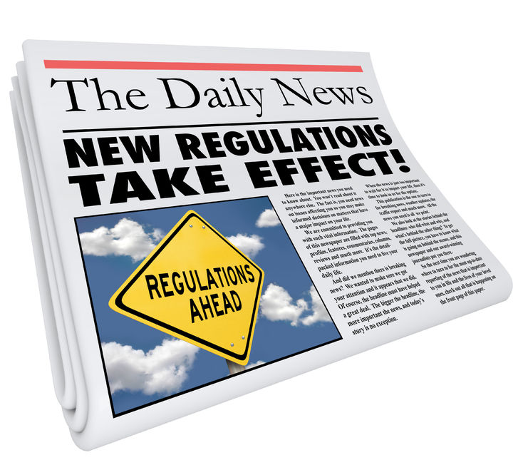 "This is a picture of a folded newspaper titled ""The Daily News"" with the article title alluding to compliance entitled ""New Regulations Take Effect!"""